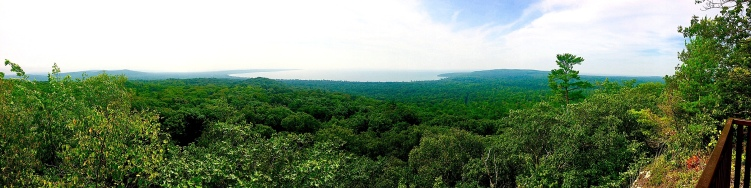 After hiking three kilometres, hikers are greeted with this spectacular view, which looks over the Boreal forest and the beautiful white sand beach of Pancake Bay on Lake Superior.