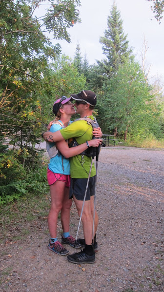 Viktoria Koskenoja and Sam Holcomb embrace after completing the Coastal Trail in 14 hours.